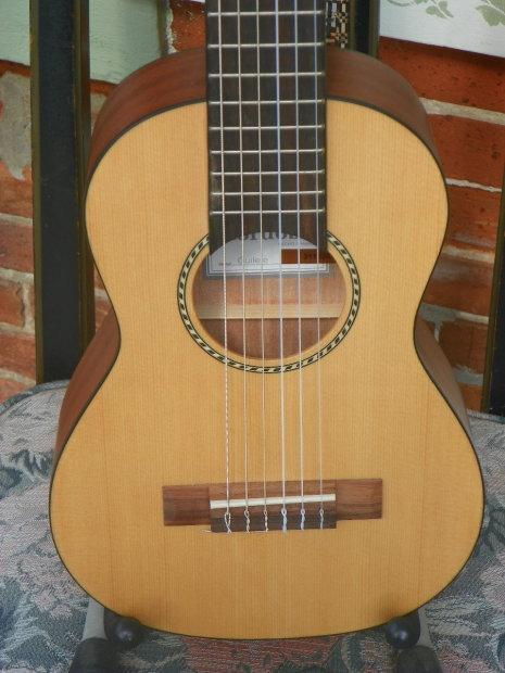 cordoba guilele 6 string acoustic ukulele guitar uke solid spruce top natural mfg refurbished. Black Bedroom Furniture Sets. Home Design Ideas