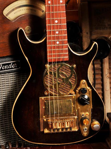 postal handmade walnut traveler mini travel electric guitar built in guitar fuel amp and speaker. Black Bedroom Furniture Sets. Home Design Ideas