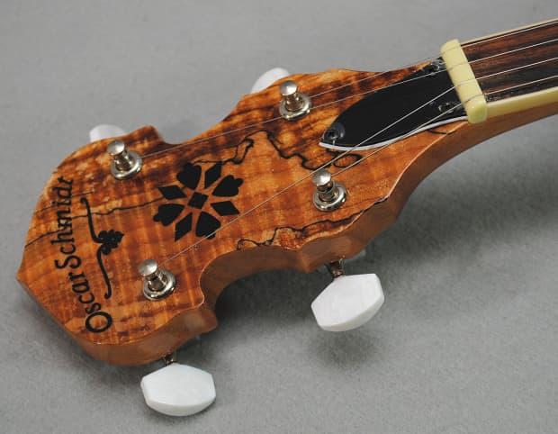 1554549 Oscar Schmidt Ob5sp 5 String Banjo Remo Head Spalted Maple Resonator Gloss Finish in addition 1552643 Oscar Schmidt Ob5sp 5 String Banjo Spalted Maple Resonator Gloss Finish W Bag additionally 1887764 Oscar Schmidt Ob5sp Spalted Maple Finish 5 String Banjo Professionally Setup moreover 1554840 Oscar Schmidt 21 Chord Electric Autoharp Solid Spruce Back Os11021ae further Bn 2310695. on oscar schmidt banjo ob5sp