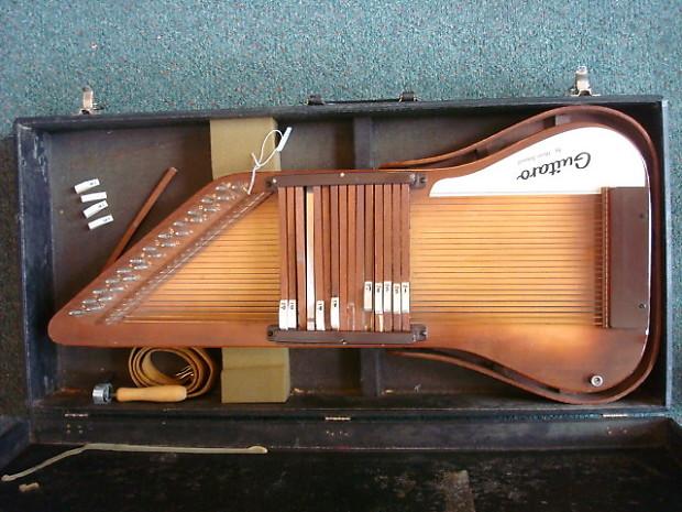 830914 Oscar Schmidt Guitaro Autoharps Sunburst additionally 118149190194263233 besides Autoharp small together with Autoharps Makes And Models as well Oscar Schmidt Model Os15b Autoharp 1. on oscar schmidt guitaro autoharp