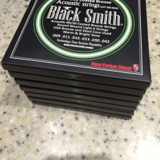 PRICED TO SELL! - 7 Sets Of 9-42 80/20 BlackSmith Carbon Coated Acoustic Strings image