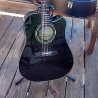 <p>Fender DG20CE-BLK with 2 packs Elixer strings, tuner, and case</p>  for sale