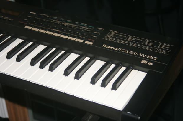 roland e14 intelligent keyboard manual