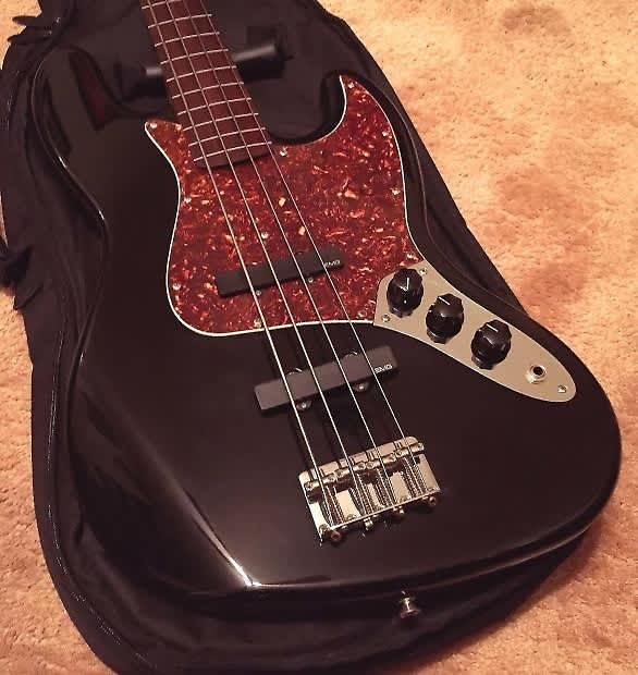 1998 black fender standard fretless jazz bass with active emg reverb. Black Bedroom Furniture Sets. Home Design Ideas