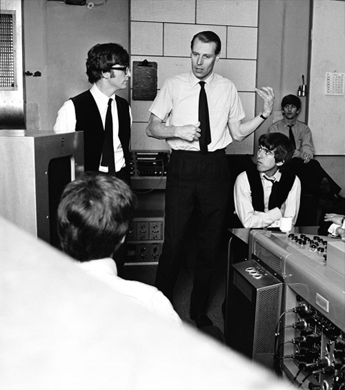 George Martin, working out a guitar phrase during the recording of the album A Hard Day's Night