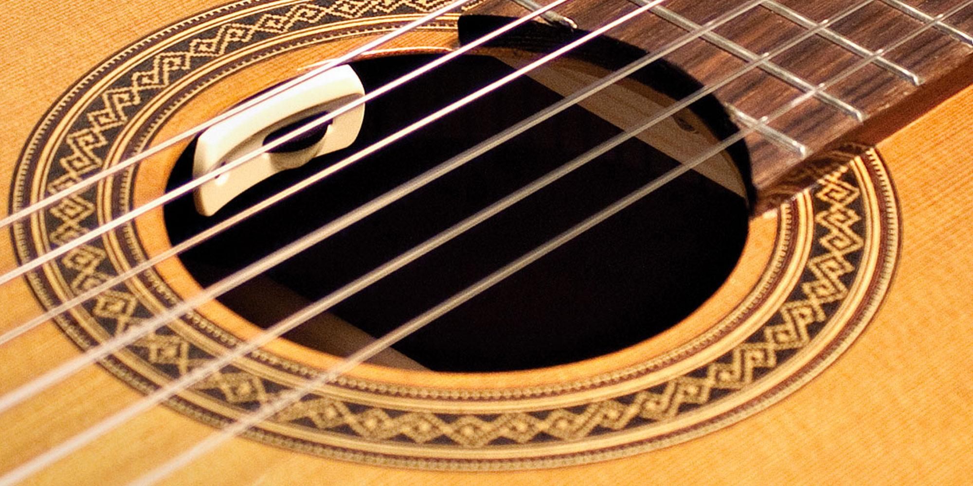 the history of acoustic guitar pickups reverb news. Black Bedroom Furniture Sets. Home Design Ideas