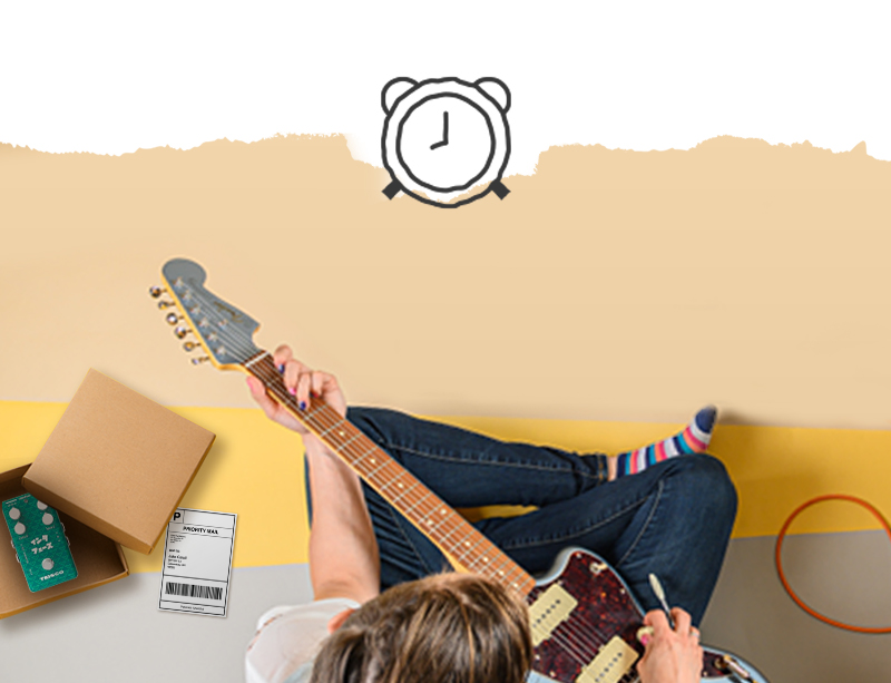 Image of someone playing a guitar and boxing up a pedal
